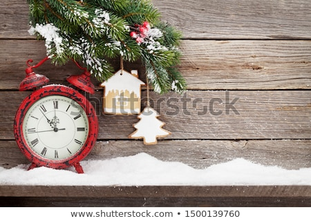 christmas fir tree branch covered by snow on wood stock photo © karandaev