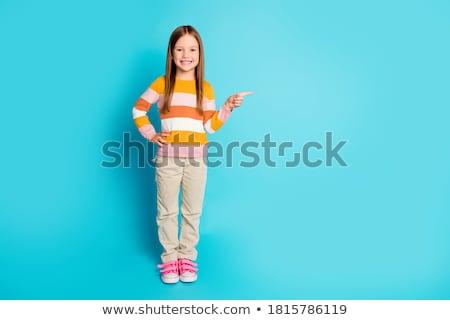 Smiling little girl promoting sale offer Stock photo © Kzenon