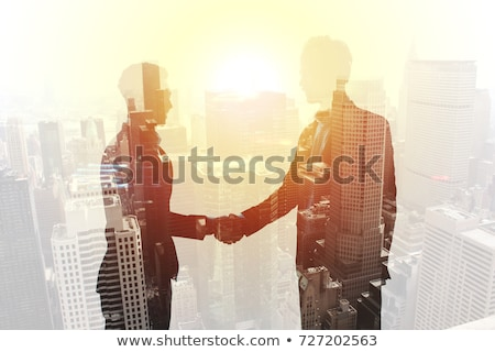 Handshake of two businessperson in office concept of partnership and teamwork.double exposure Stock photo © alphaspirit