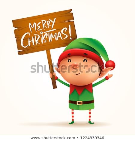 Merry Christmas! Little elf holds wooden board sign in Christmas Stock photo © ori-artiste