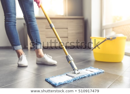 woman or housewife with mop cleaning floor at home Stock photo © dolgachov