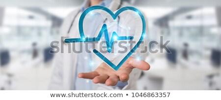 3d Man Holding Heart Stock photo © sdecoret