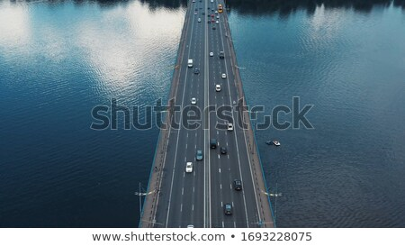 Vehicles on bridge over water Stock photo © lovleah