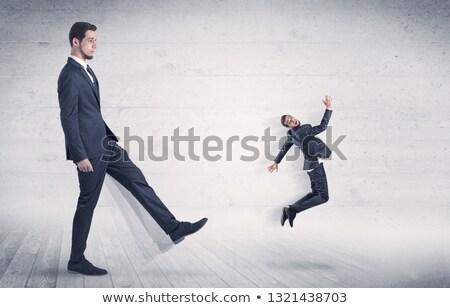 Nagy férfi rúg kicsi koszos óriás Stock fotó © ra2studio