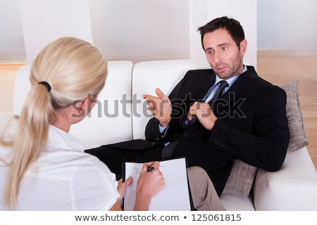 businessman listen to young attractive man explaining about his stock photo © snowing