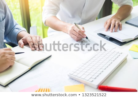 Group of diverse young adults university tutor presentation work Stock photo © snowing