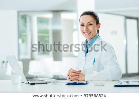 Portrait Female Doctor Working In Hospital Office With Computer Smiling Stock photo © diego_cervo