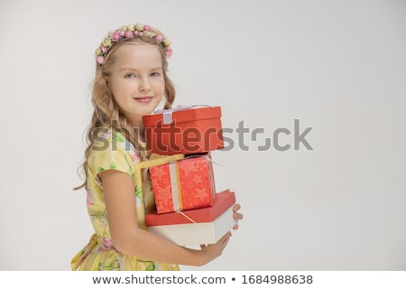 Beautiful blonde woman in elegant dress and heels with stack of presents. Stock photo © studiolucky