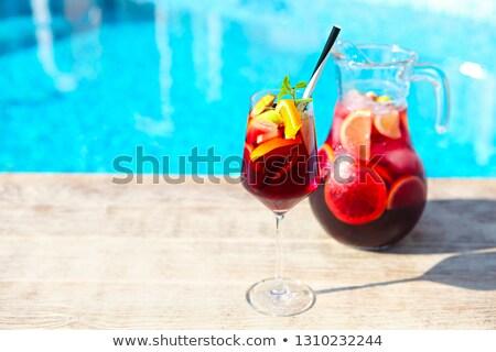 Refreshing classic fruit sangria by the pool Stock photo © dashapetrenko
