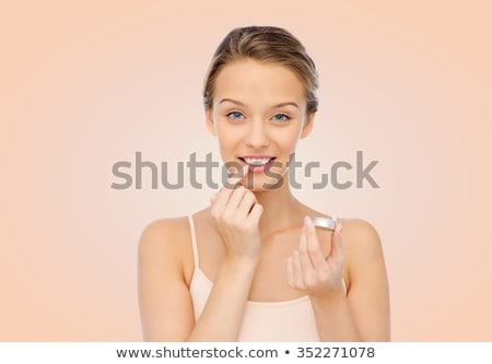 Young Woman Applying Balm On Her Lips Stock photo © AndreyPopov