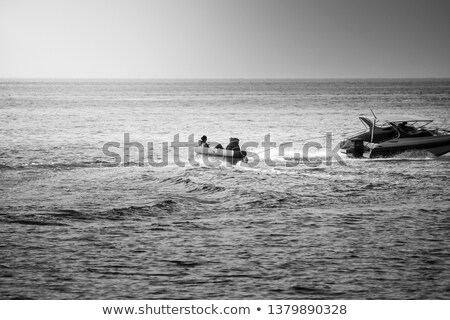 Boy tows girl on raft Stock photo © jsnover