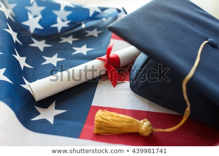 graduate students with diplomas and american flag Stock photo © dolgachov