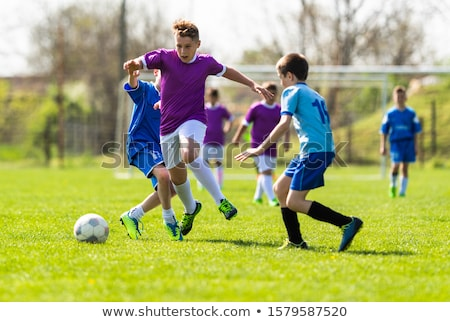 Children Play Soccer Game. Young Boys Running and Kicking Stock photo © matimix