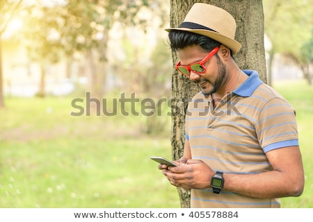 smiling indian man with smart watch at office Stock photo © dolgachov