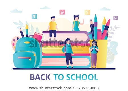 standing boy with books backpacks with stationery stock photo © robuart