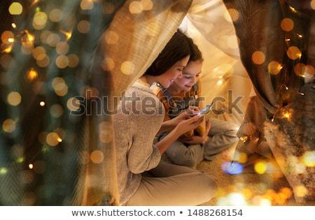 счастливая семья смартфон дети палатки домой семьи Сток-фото © dolgachov