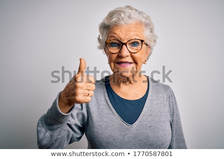 Feliz altos mujer gafas Foto stock © dolgachov