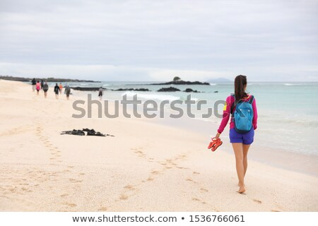 Galapagos Islands - woman on cruise ship tour visiting Playa las Bachas Beach Stock photo © Maridav