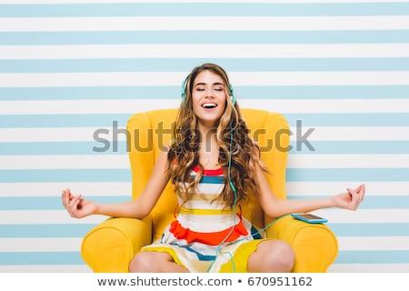 Cute sonriendo femenino auriculares sesión suave Foto stock © pressmaster