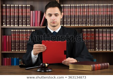 lawyer judge reading documents at desk in courtroom. Stock photo © snowing