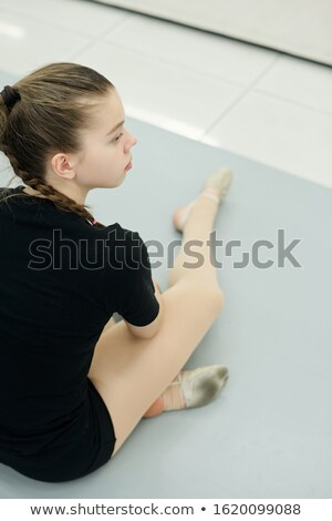 Curious girl watching rehearsal in gym Stock photo © pressmaster