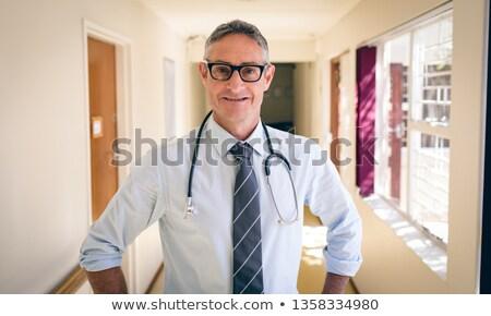Retrato caucásico doctor de sexo masculino pie corredor casa de retiro Foto stock © wavebreak_media