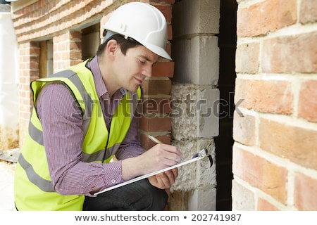 Construction manager and architect checking the insulation works Stock photo © Kzenon