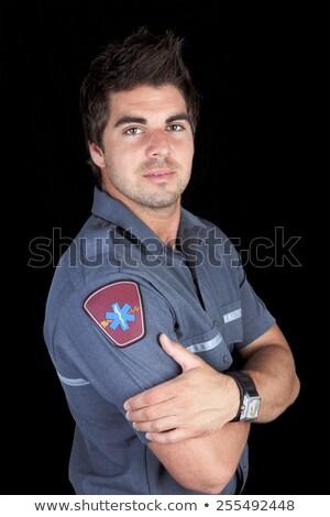 Paramedico dipendente fronte nero sfondo ospedale Foto d'archivio © Lopolo