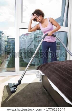 Moe afrikaanse vrouw stofzuiger home huishouden Stockfoto © dolgachov