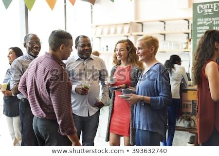 Conversa pessoas amigos reunião banquete três Foto stock © robuart