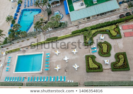 Aerial view at two empty deckchairs on the beach Stock photo © boggy