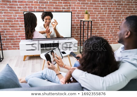 Family Watching TV Through Tablet Streaming Television Stock photo © AndreyPopov