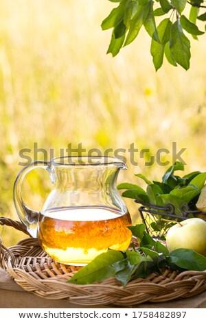 Manzanas cesta jarra vinagre mesa frutas Foto stock © dolgachov