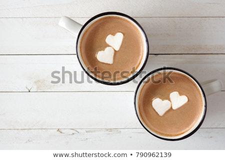 Iki kadın içme sıcak çikolata hatmi içecekler parti Stok fotoğraf © dolgachov