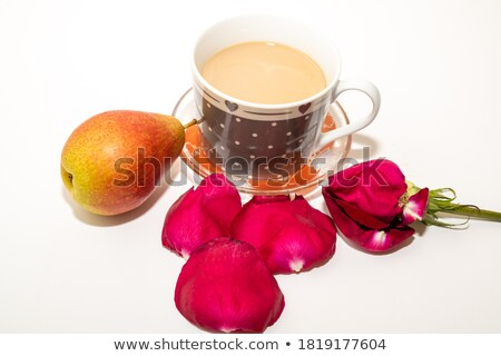 Red tea in ceramic cup with burlap background Stock photo © Ansonstock