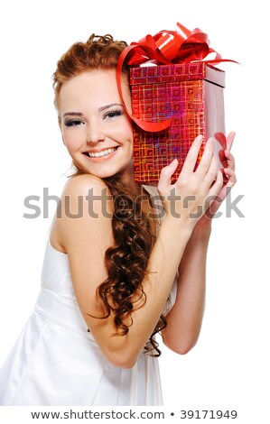 beautiful woman holding present on her head stock photo © Rob_Stark