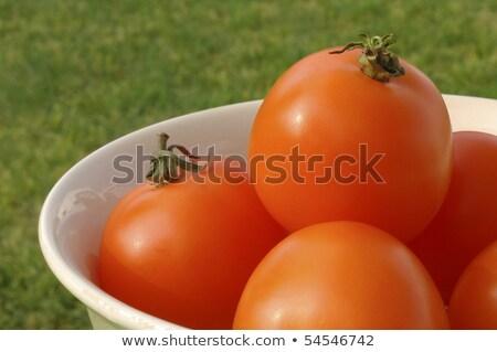 Sunlit Bowl Of Orange Low Acid Tomatoes
