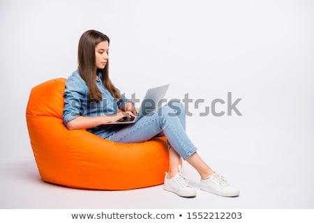 женщину · студент · сидят · ноутбука · изолированный · белый - Сток-фото © dacasdo