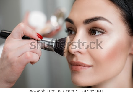 Lady applying eye Mascara Stock photo © vectomart