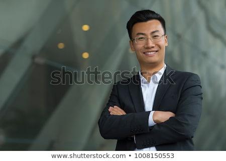 chinês · homens · cara · câmera · sorridente · óculos - foto stock © cozyta