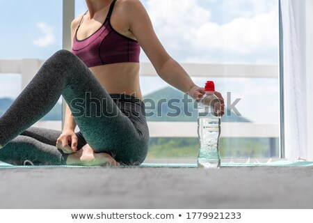 woman with bottle Stock photo © dolgachov