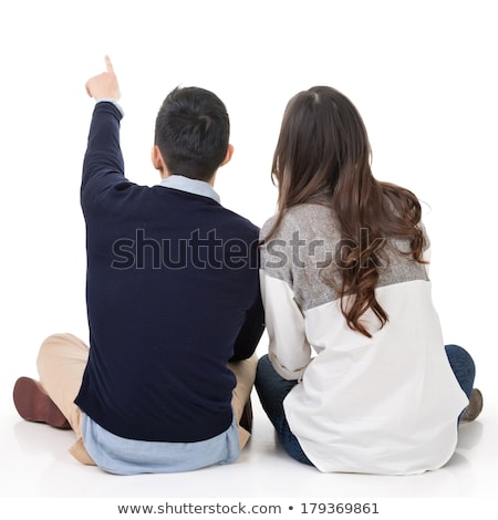 two young casual men sitting back to back  stock photo © feedough