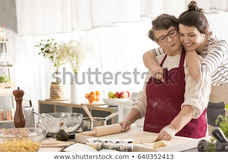 Fiatal nő főzés nagymama konyha portré segítség Stock fotó © photography33