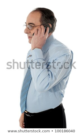 side view of a senior manager attending phone call stock photo © stockyimages