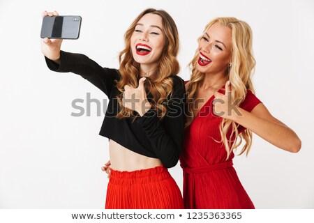 Foto stock: Dois · belo · mulheres · vestidos · estúdio · retrato