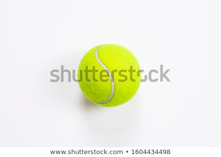 Tennis balls on racket and a person in background Stock photo © mnsanthoshkumar