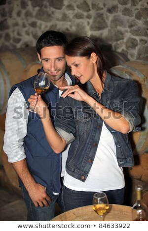 Stock photo: couple learning how to taste wine