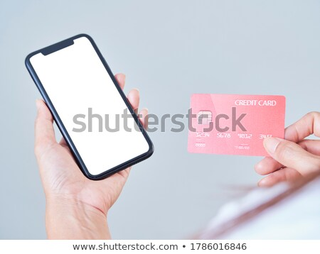 smart woman holding card on white background stock photo © photography33