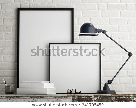 gallery interior with empty frames on dark blue wall stock photo © victoria_andreas