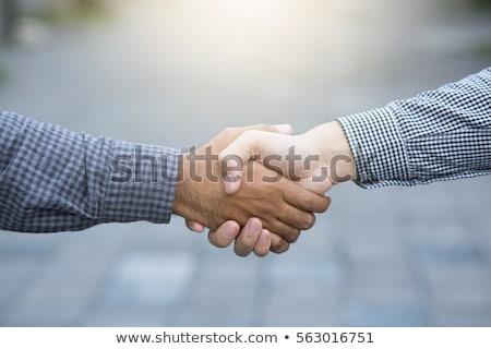 дрожания рук бизнесмен бизнеса заседание работу друзей Сток-фото © ozaiachin